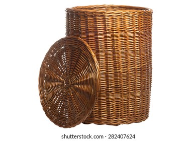 Wicker basket with lid on white background