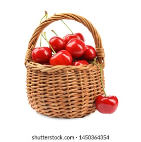 Wicker basket with ripe sweet cherries on white background