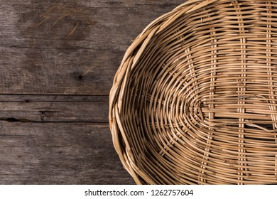Wicker baskets on wooden table background