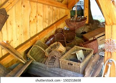 Wicker baskets in a wooden barn