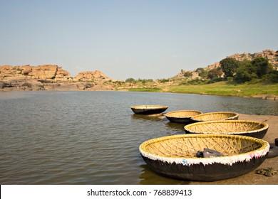 Wicker boats on the river bank in Hampi, Karnataka, India