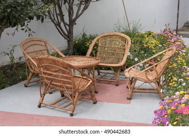 Wicker or Cane chairs. Rattan chair set in the garden. image in natural light.
