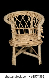 Wicker chair isolated on black background