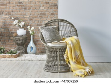 wicker chair and yellow blanket