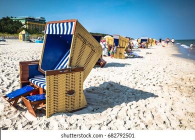 Wicker chairs on Jurata beach on sunny summer day, Hel peninsula, Baltic Sea, Poland