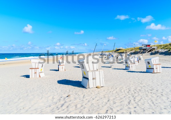 Wicker chairs on Kampen beach on sunny summer day, Sylt island, North Sea, Germany