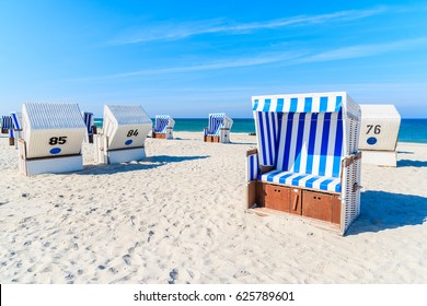 Wicker chairs on white sand Kampen beach, Sylt island, North Sea, Germany