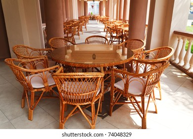Wicker chairs in a open-air cafe