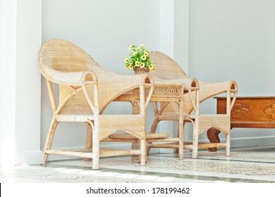 wicker chairs outdoor sunlight scene