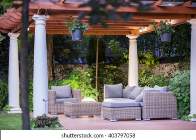 Wicker chairs and table on the terrace