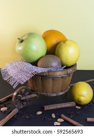 Wicker decorative cart with fruits on white background