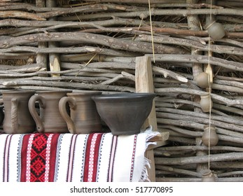 wicker fence and a clay pots. Ukrainian national style