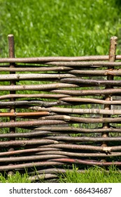 A wicker fence made of wood in nature.