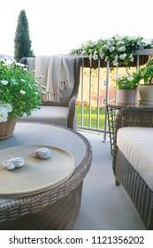 Wicker furniture on balcony