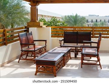 wicker furniture on the balcony.