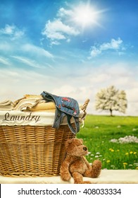 Wicker laundry basket with clothes against a blue sky