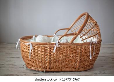 Wicker old cradle for sleeping baby.