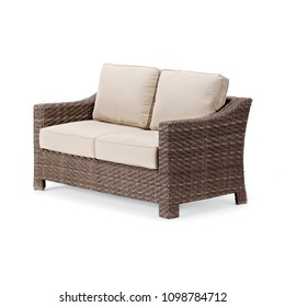 Wicker Outdoor Sofa Isolated on White Background. Side View of Dining Sofa with Beige Fabric Cushion Seat. Patio Furniture. All-Weather Rattan Loveseat