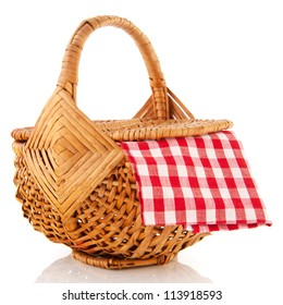 Wicker picnic basket with checkered red and white table cloth