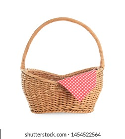 Wicker picnic basket with checkered tablecloth on white background
