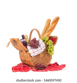 Wicker picnic basket filled with bread grapes and wine isolated over white background