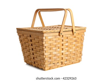 A wicker picnic basket on a white background