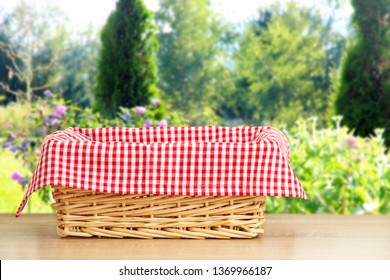 Wicker picnic basket on a wooden table,holiday wallpaper
