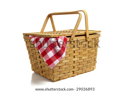 A wicker picnic basket with a red gingham cloth on a white background