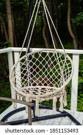 wicker rocking chair hanging on the veranda