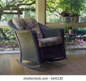 Wicker rocking chair on screened porch