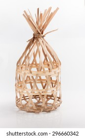 Wicker round bamboo basket on white background.