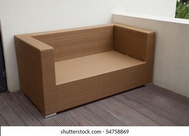 Wicker sofa in yard