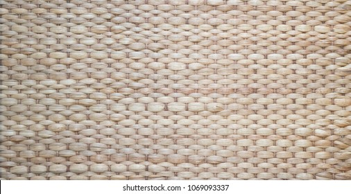 wicker of straw and reed mat woven stripe lines pattern texture for wallpaper background