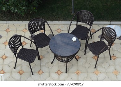 wicker table and chairs stand in the street