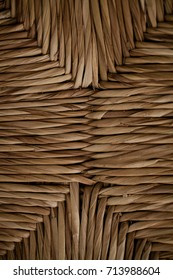Wicker texture and background for design, close up view of handmade wicker chair.