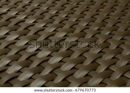 wicker texture as dark brown plastic background