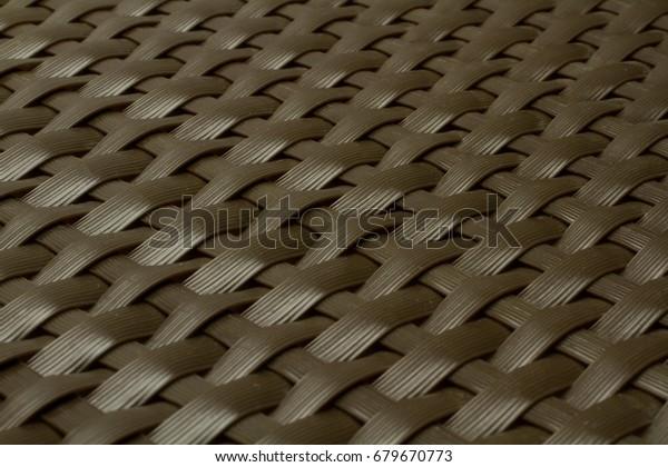 wicker texture as dark brown plastic background
