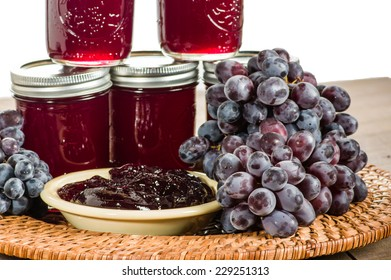 Wicker tray with grapes and fresh jelly