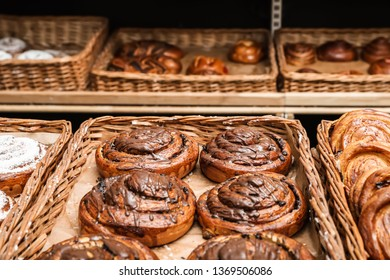 Wicker trays with different sweet buns in bakery