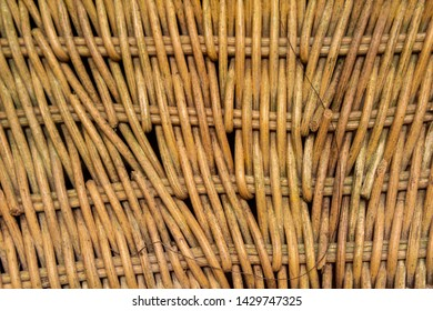 Wicker woven chair close up. Wooden wicker weave texture / pattern.