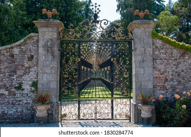 WICKLOW, IRELAND - JUNE 30, 2014: A black and gold painted gate at the gardens.