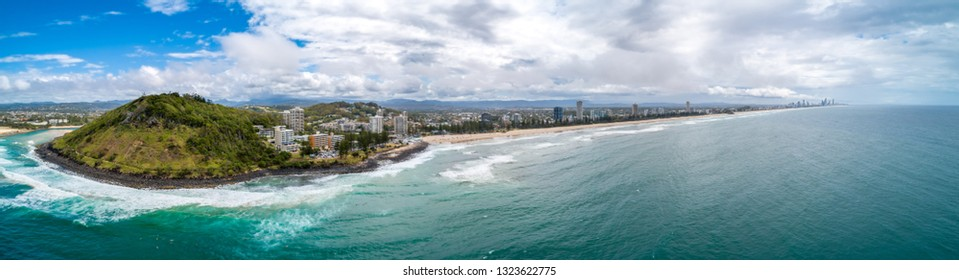 Wide aerial panorama of Burleigh Heads ocean coastline and national park. Gold Coast, Queensland, Australia