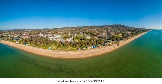 Wide aerial panorama of colorful beach huts and scenic coastline in Dromana, Victoria, Australia