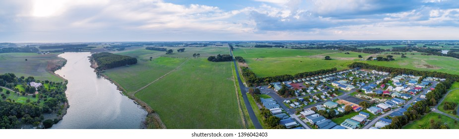 Wide aerial panorama of Hopkins River, Holiday Park and grasslands in Warrnambool, Australia