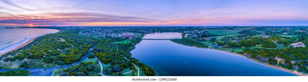 Wide aerial panorama of Hopkins River and Warrnambool at sunset in Victoria, Australia