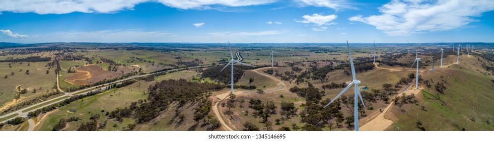 Wide aerial panorama of Hume Highway and wind farm in beautiful Australian countryside. Breadalbane, NSW, Australia