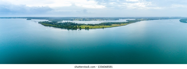 Wide aerial panorama of Manning River with copy space. Harrington, New South Wales, Australia