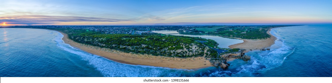 Wide aerial panorama of Point Ritchie lookout and Hopkins River mouth at sunset. Warrnambool, Australia