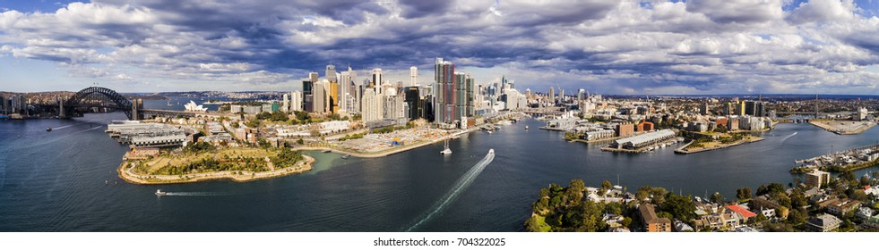 Wide aerial panorama of Sydney City architecture between the SYdney Harbour bridge and ANZAC bridge on a sunny day.