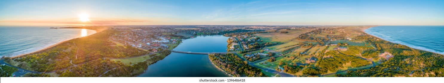 Wide aerial panorama of Warrnambool and Hopkins River at sunset. Victoria, Australia